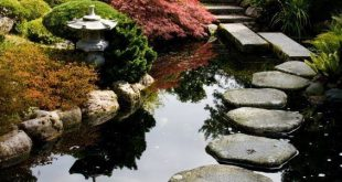 Zen garden path over a pond, Portland Japanese Garden, Portland, Oregon, USA. #j